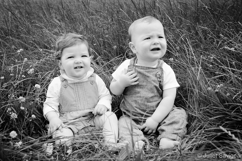 Twin Babies In The Grass