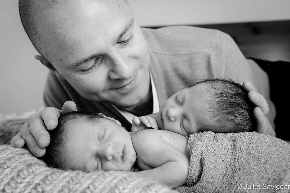 Daddy with newborn baby twins