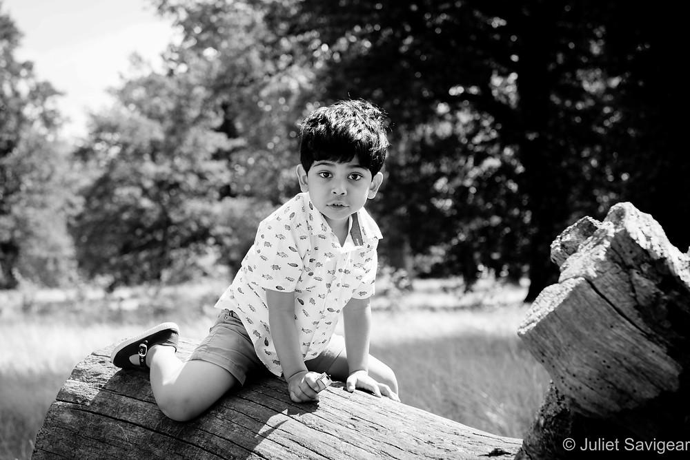 Child climbing log