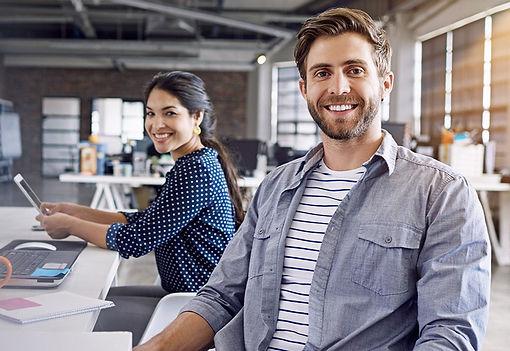 Male-female-happy-at-work_edited.jpg