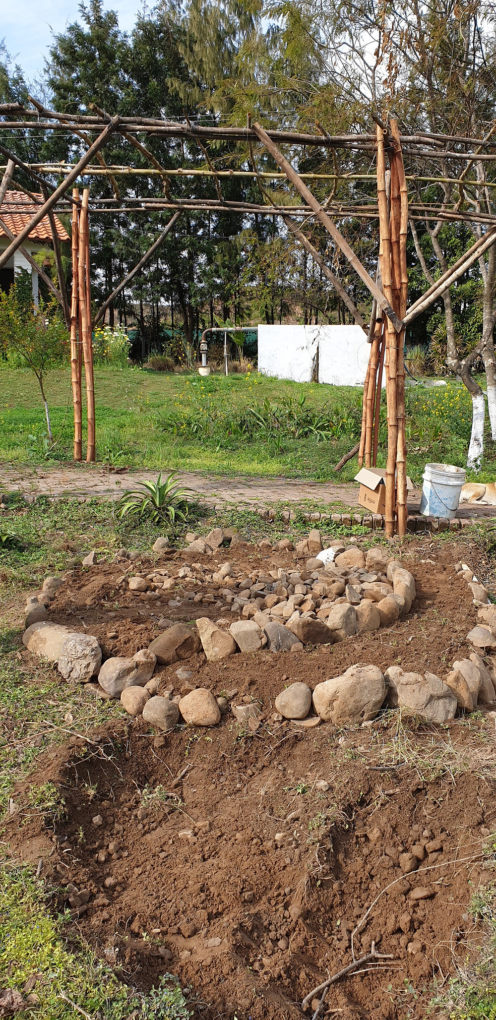 Piling up stones, and then soil on the spiral