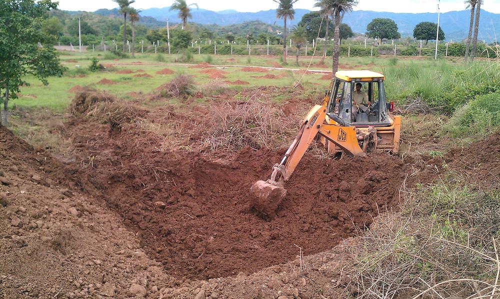 JCB digging a reservoir