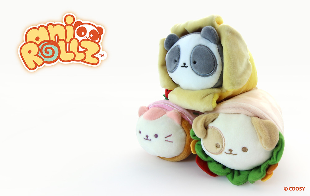 Image of Banana Pandaroll, roll cake Kittiroll, and burrito Puppiroll stacked on top of each other.