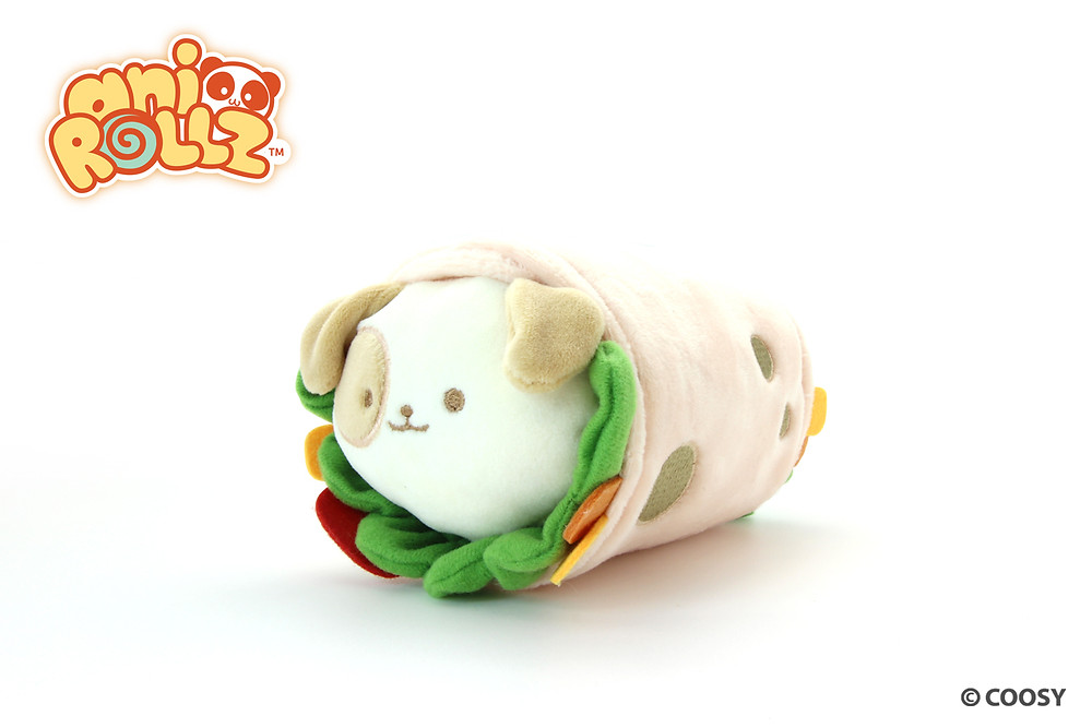 Image of Puppiroll in a burrito blanket.