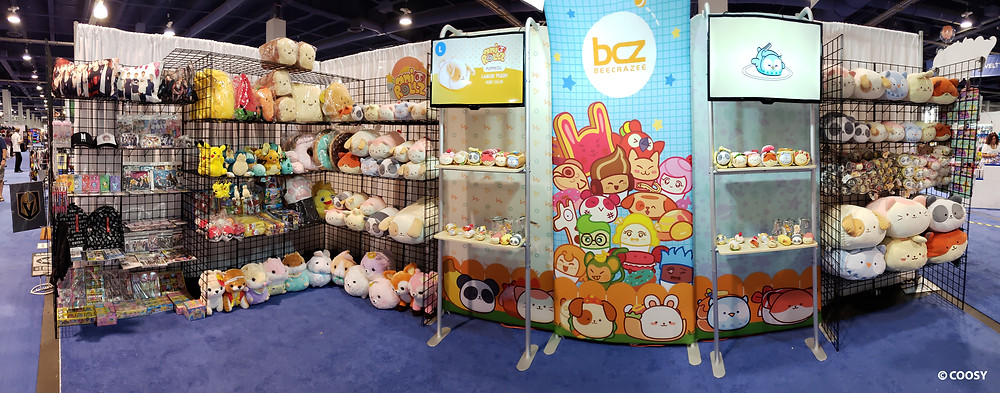 Image of the Coosy ASD show featuring various plush toys and displays