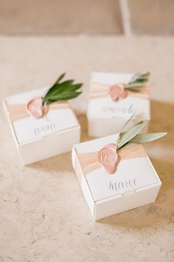 wedding flavors with wax seals and greenery