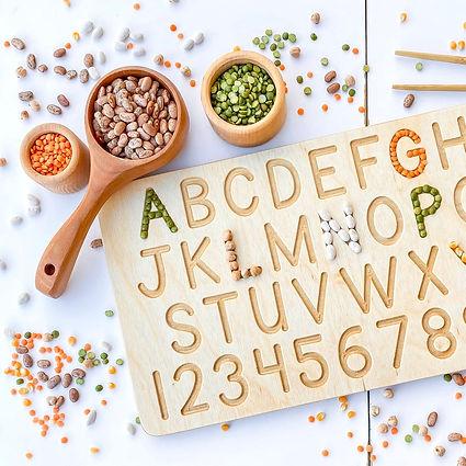 Wooden children's language alphabet board