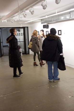 OaCHExplainsDrawings To viewers Opening.