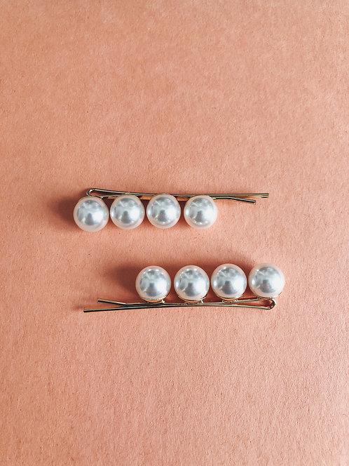 A pair of 4 Pearls Pins