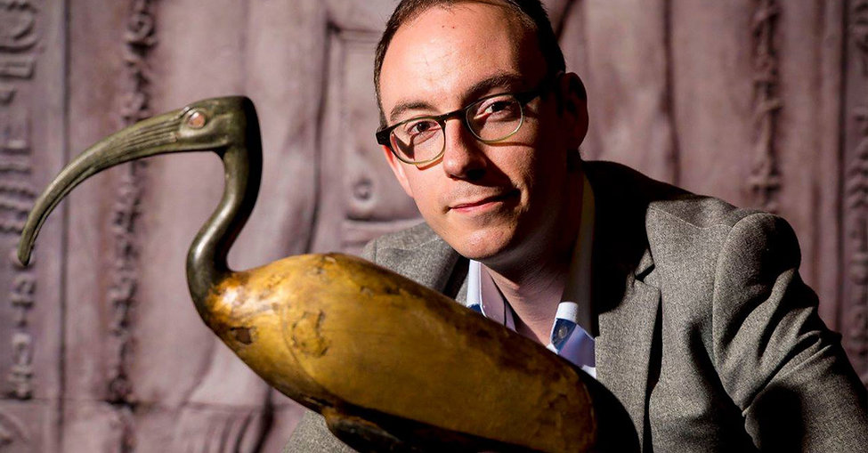 Dr Campbell Price with mummified Ibis coffin