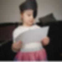Girl holdng mini monsters box map