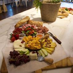 Artful arrangement of fruit & cheese