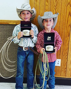 "Zane & Payson after winning belt buckles at a ""dummy"" roping"