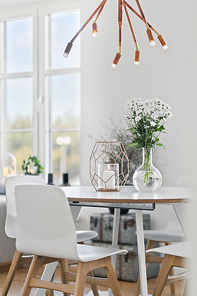 Dining table in clean, modern interior.j