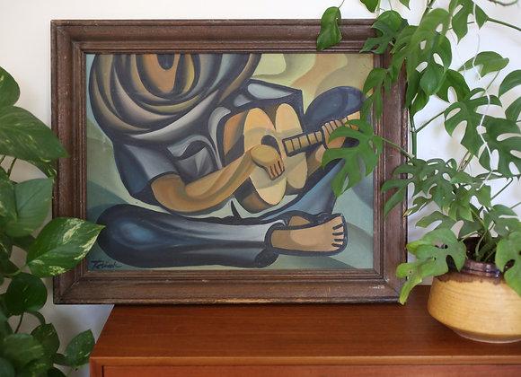 ציור ממוסגר נגן גיטרה