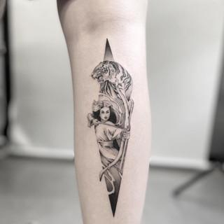 tiger arrow tattoo