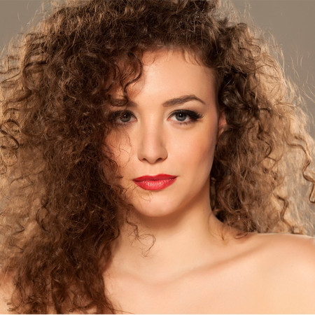WHAT CAUSES DRY CURLY HAIR??