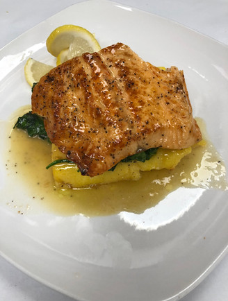 Salmon spinach & polenta lemon buerre blanc sauce.