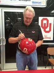 Steve Owens Autographing 1969 Oklahoma Sooners Helmet