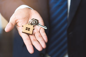 close-up-view-home-keys-agent-hand-givin