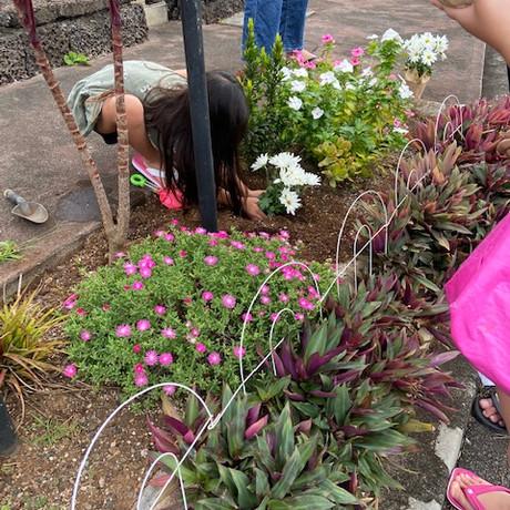 Kokone uses her garden tool