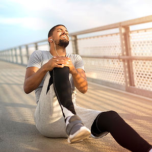 sportsman-having-knee-injury-problem-dur