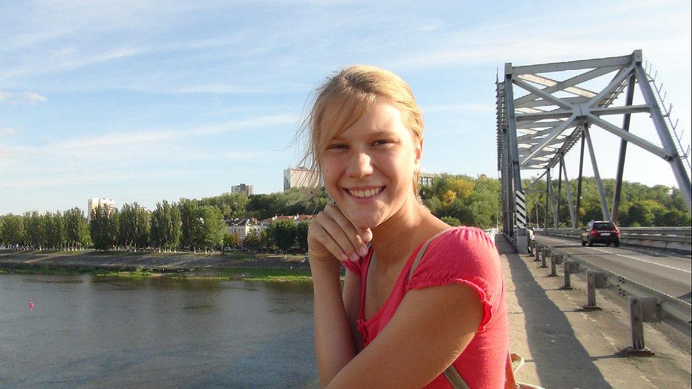 Across the river bridge.