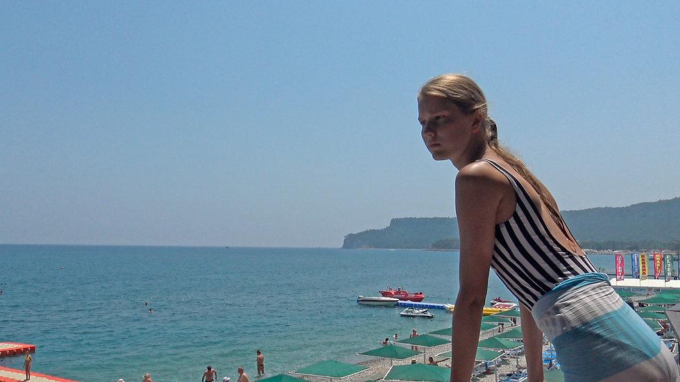 Sunbathing by the sea
