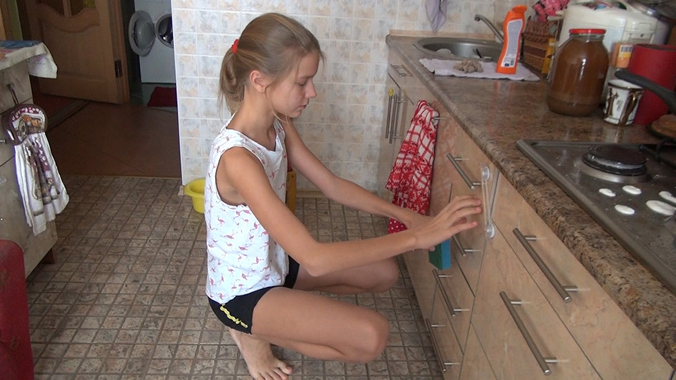 Milana cleans the kitchen
