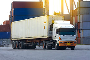 container-white-truck-in-ship-port-logis