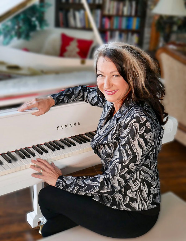 Rosalie Drysdale Seated at White Baby Grand Piano