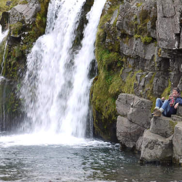 Rosalie Contemplating Water Falls in Iceland