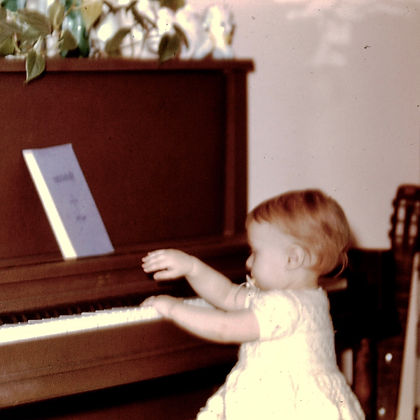 Rosalie Drysdale Age 2 at Piano