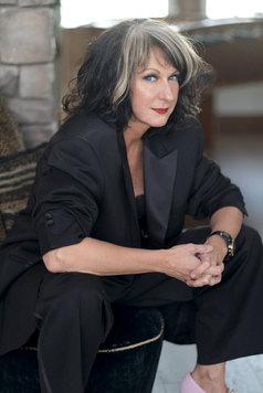 Rosalie Drysdale Black Suit Seated