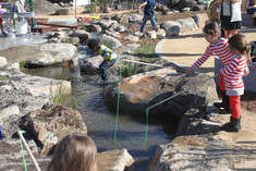 The recirculating water feature references the riparian ecosystem of the Russian River.