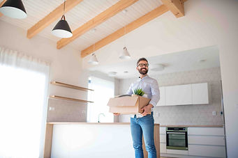 mature-man-standing-in-unfurnished-house