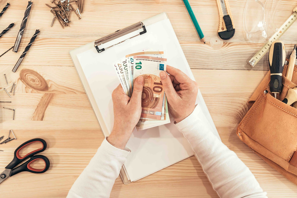 female-carpenter-counting-money-top-view