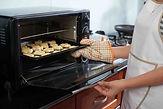 woman-baking-homemade-cookies-9GZMR4X.jp