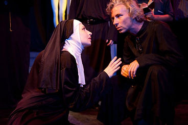 Timothy McCown Reynolds as Father Barre with Olivia Baseman as Sister Jeanne in THE DEVILS Directed by Ian W. Hill