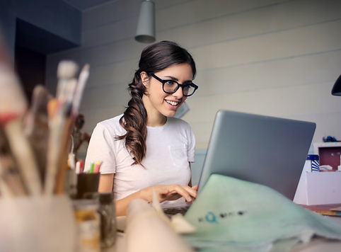photo-of-woman-using-her-laptop-935756.j