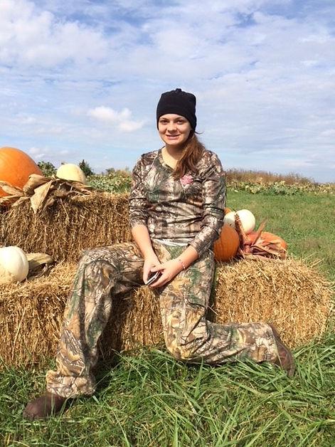 Gracie Sitting on Hay Bale.jpg