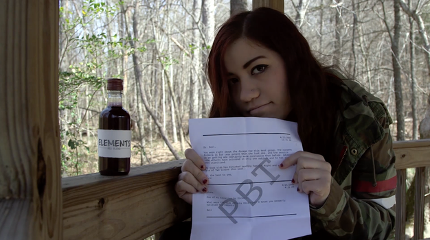 Jane (Kendall Brewer) with clues from the show