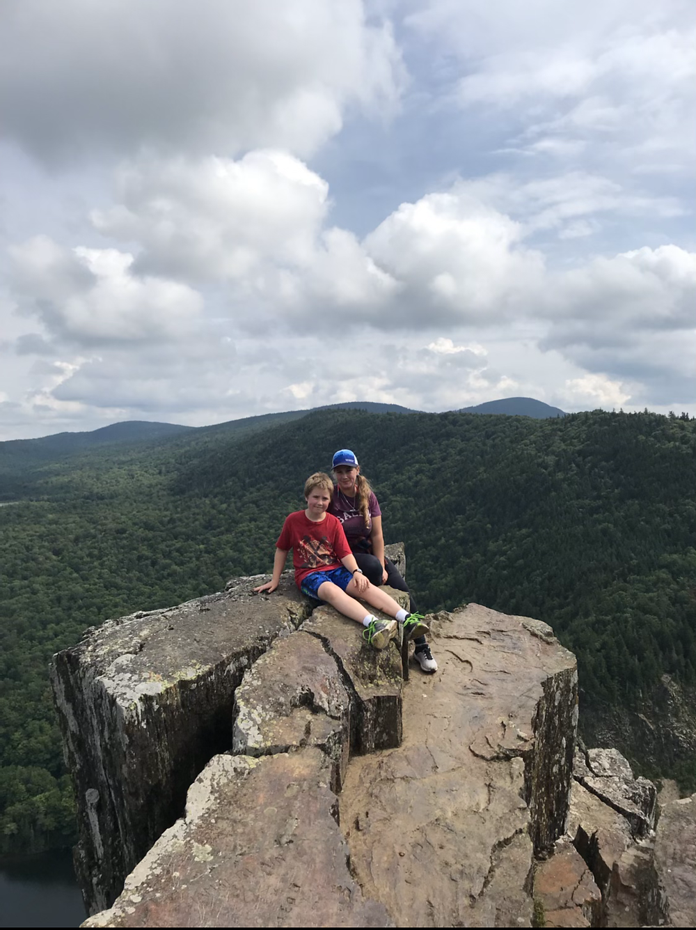 My son and I sitting on the edge on table rock
