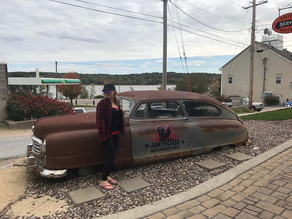Me standing in front of the Antique Archaeology car