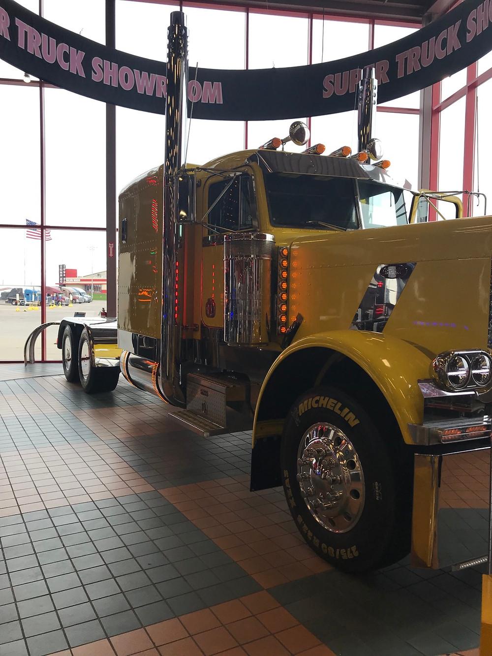 Big tractor trailer truck inside the Iowa 80