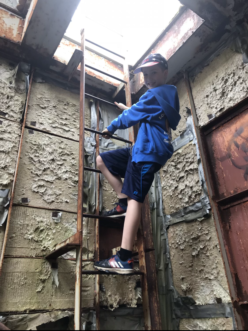 My son climbing up to the top of the tower a couple years ago