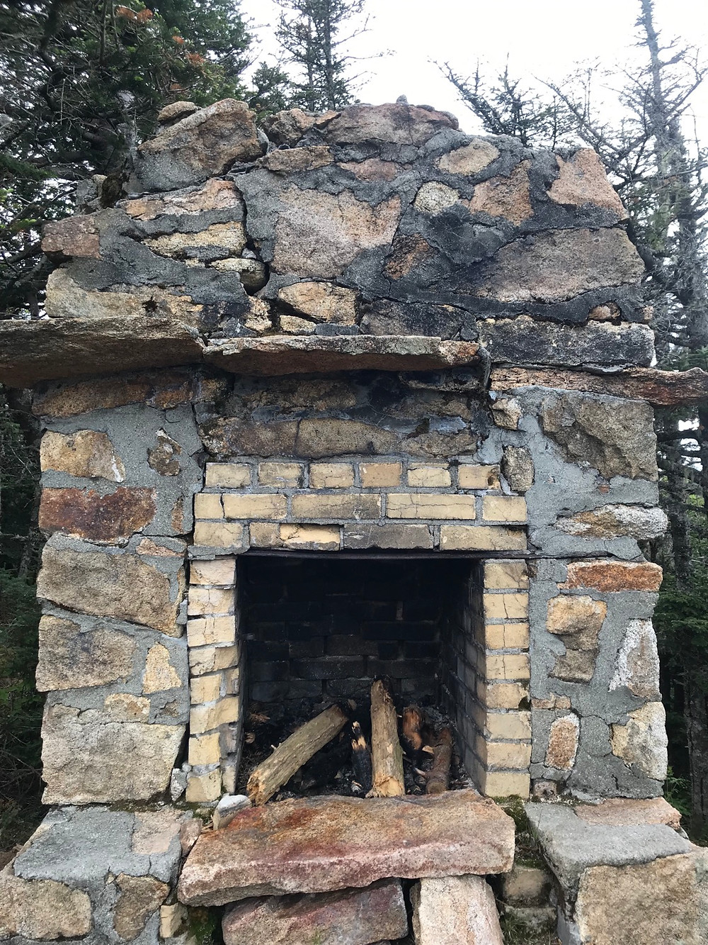 A fire place is all that remains of an old shelter