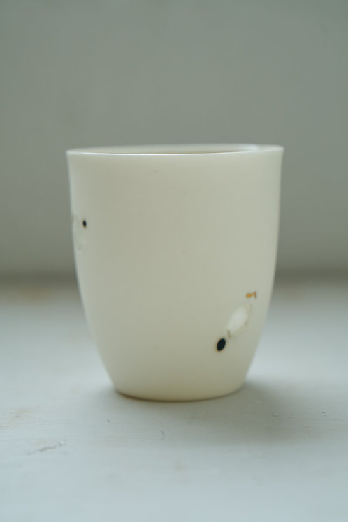 Coffee cup with light holes, gold and black dots