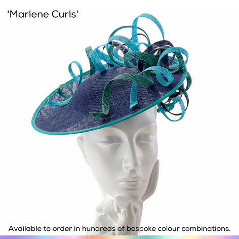 Marlene Curls.  A flattering saucer shaped headpiece, featuring tumbling ribbons of curled sinamay in complimentary colours.  Available to order in thousands of colour combinations to match your outfit perfectly.  Handmade by Marvellous Millinery, Winchester, Hampshire UK.  Bespoke ladies wedding hats for Mother of the Bride, Mother of the Groom, Top Table Wedding Guests, Ladies Day at Royal Ascot, Glorious Goodwood, Garden Parties at Buckingham Palace and Royal Investitures.