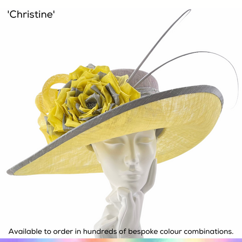 Christine.  A generous ladies picture hat featuing a gently upturned brim and a large crown.  Trimmed with a gorgeous oversized English rose, handmade in different silks and finished off with a silk hatband and bind and a pair of arching quills.  Available to order in thousands of colour combinations to match your outfit perfectly.  Handmade by Marvellous Millinery, Winchester, Hampshire UK.  Bespoke ladies wedding hats for Mother of the Bride, Mother of the Groom, Top Table Wedding Guests, Ladies Day at Royal Ascot, Glorious Goodwood, Garden Parties at Buckingham Palace and Royal Investitures.